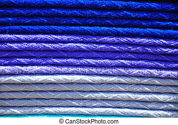 Stack of traditional woven alpaca blankets in different...