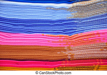 Stack of blue and pink alpaca blankets on traditional market...
