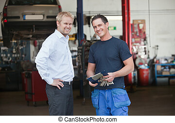 Business Customer Standing With Mechanic - Portrait of a...