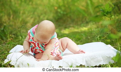 Newborn baby outdoors