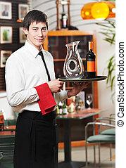 waiter in uniform at restaurant