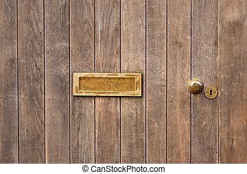 letter box in wooden door