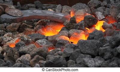Blacksmith at work - Blacksmith shaping a horseshoe