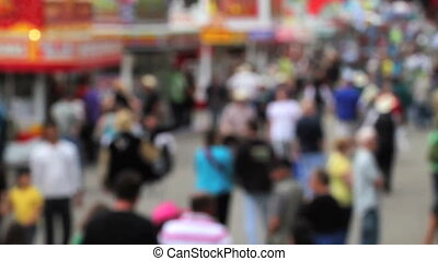 Crowd walking - Soft focus shot of large crowd walking in...