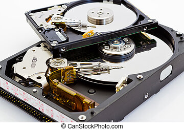detail comparison of an open 25 and 35 disk drive on a white...