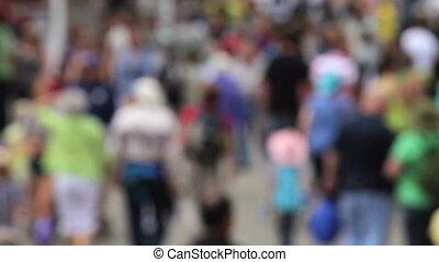 Crowd walking - Soft focus shot of large crowd walking in...