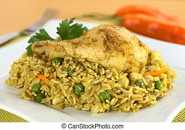 Peruvian dish called Arroz con Pollo (Rice with Chicken),...