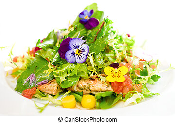 Green salad on a white plate with flowers, meat, corn and...
