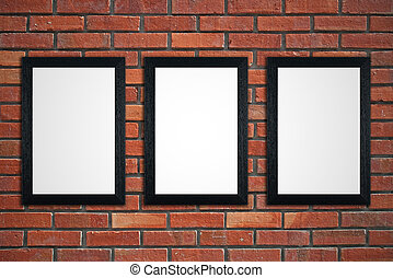 Frames on red brick wall - Three black picture frames on red...