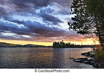 Dramatic sunset at lake - Dramatic sunset at Lake of Two...
