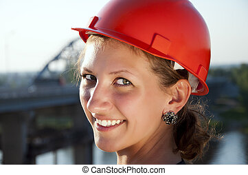 Young architect-woman wearing a protective helmet