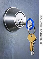 Keys in lock - Keys inserted in door lock close up