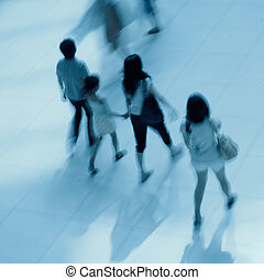 abstract business people rushing lobby blur motion -...