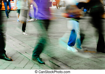 people walk on street - abstract blur motion of busy big...