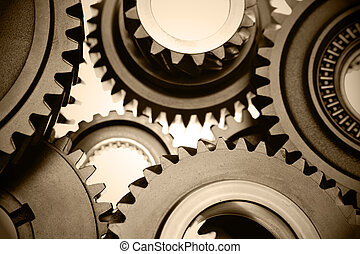 Gears - Closeup of steel gears meshing together