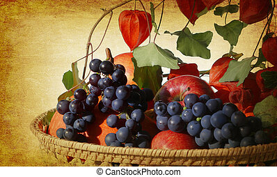 vintage garden harvest - garden harvest in a basket on old...