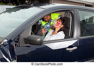 Unconscious driver - Young woman being resuscitated after a...