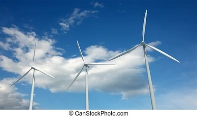 Windmills against time lapse clouds - Power generator...