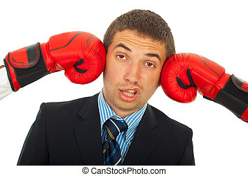 Kicked by two boxing gloves - Business man being kicked by...