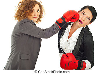 Business women fight with boxing gloves - Two business women...
