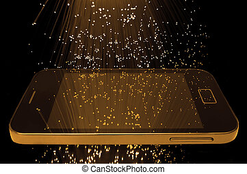 Many illuminated golden fiber optic light strands cascading down against a black background and reflecting on the screen of a smart phone in the foreground