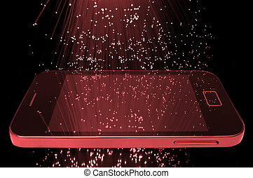 Many illuminated red fiber optic light strands cascading down against a black background and reflecting on the screen of a smart phone in the foreground