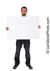 Young man - Attractive young man holding blank white sign...