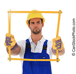 Construction worker holding folding rule. All on white...