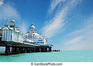 Eastbourne pier England with blue sky
