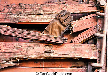 Grungy Leather Glove in rotten wood side wall - Abandoned...