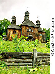 Wooden church with the wooden fence.