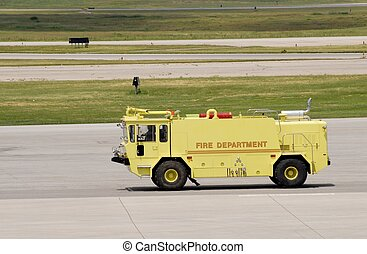 Airport Firetruck - vintage type Firetruck on the taxiway at...
