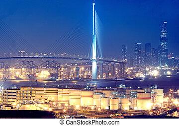 gas container and bridge at night,hong kong