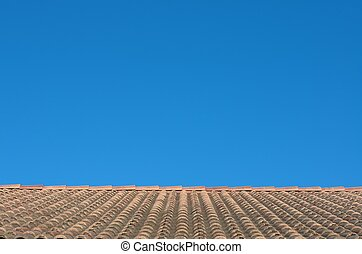 tiled roof on the sky