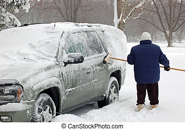 After The Snowstorm - Brushing the snow from our vehicle...