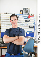 Handsome mechanic at auto repair shop - Portrait of a...
