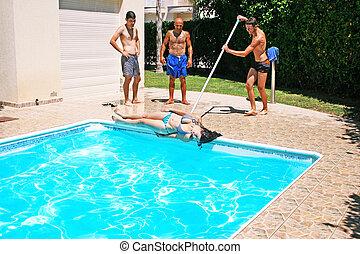 People at swimming pool - Man throwing woman to swimming...