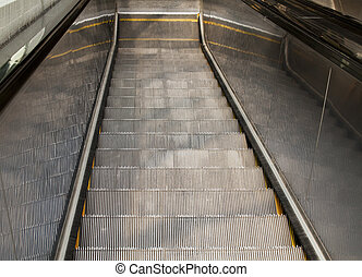Looking Down An Escalator - Looking down from the top of an...