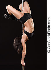 Young sexy woman exercise poledance - Young sexy woman...