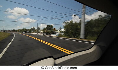 View through rear window. - Driving on a highway in southern...