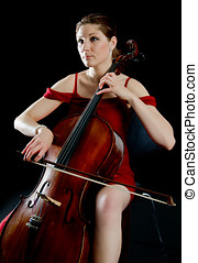 Woman playing the cello in red dress - A beautiful woman...