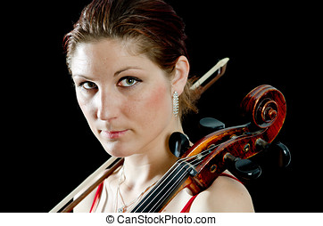 Serious cello player with her bow on the shoulder - A...