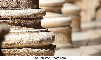 Antique stone pillar rack focus