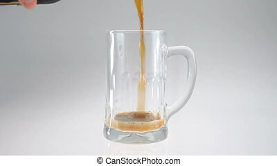 Beer pour in glass beer mug