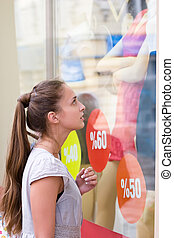 discount showcase - portrait of attractive girl is loking on...