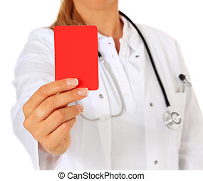 Red card - Doctor showing red card. All on white background....