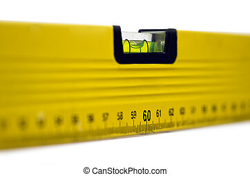 Yellow spirit level; well-used spirit level isolated against...