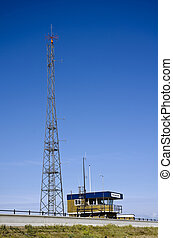 Coastguard station; next to radio mast, against deep blue...