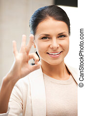 lovely teenage girl showing ok sign - bright picture of...