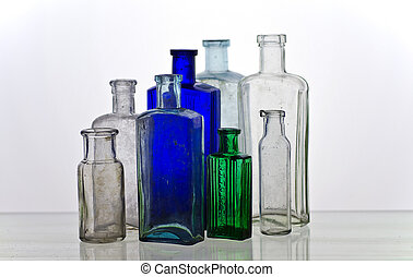 Vintage medicine bottles; group of variously-colored...